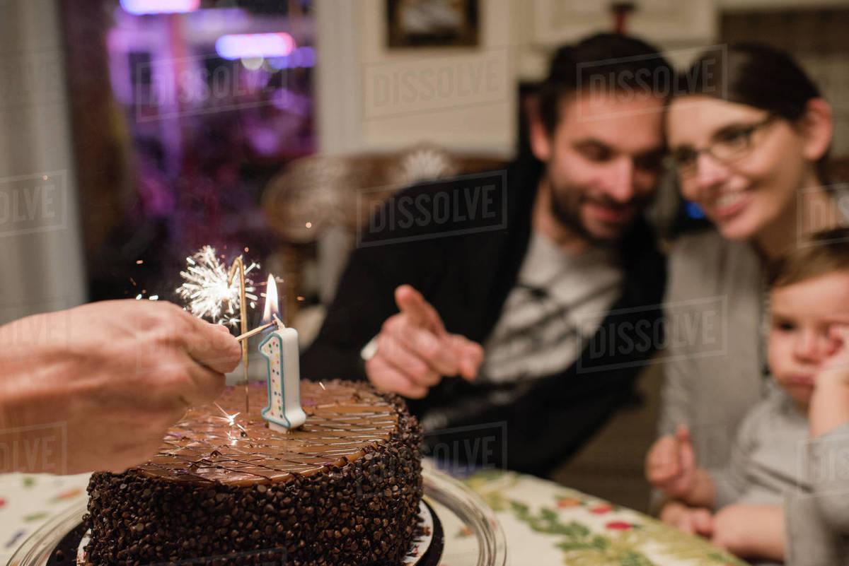 Pleasing Couple And Baby Boy With First Birthday Cake Stock Photo Dissolve Funny Birthday Cards Online Amentibdeldamsfinfo