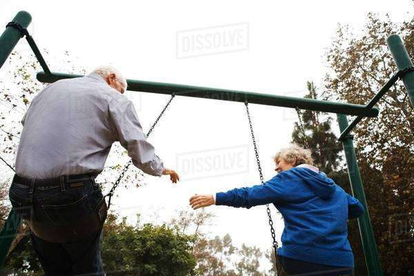Husband and wife on swing Royalty-free stock photo