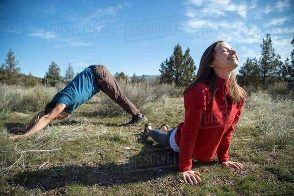 Couple practising yoga, Smith Rock State Park, Oregon Royalty-free stock photo