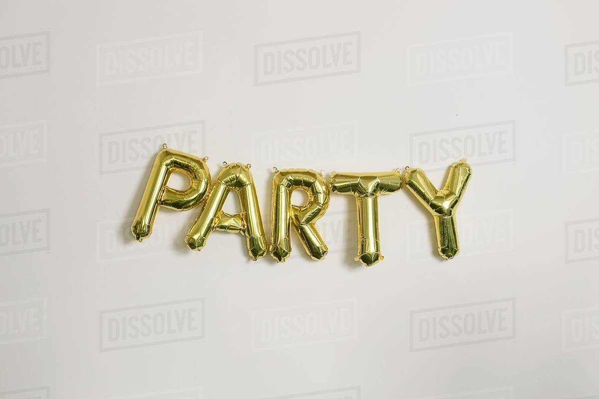 Word party in gold inflatable capital letters stock photo