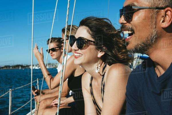 Friends enjoying view on sailboat, San Diego Bay, California, USA Royalty-free stock photo