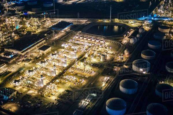 Aerial view of oil refinery and storage tanks illuminated at night, Los Angeles, California, USA Royalty-free stock photo