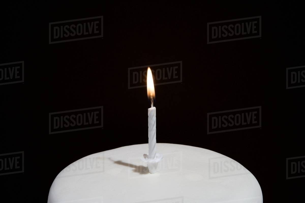 Candle On A Birthday Cake Stock Photo Dissolve