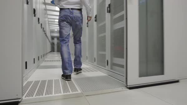 MS TS Man walking with laptop in data center / Amsterdam, North Holland, Netherlands Royalty-free stock video