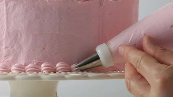 Decorating a strawberry cream cake Royalty-free stock video