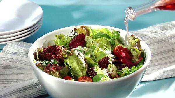 Putting vinegar on mixed salad Royalty-free stock video