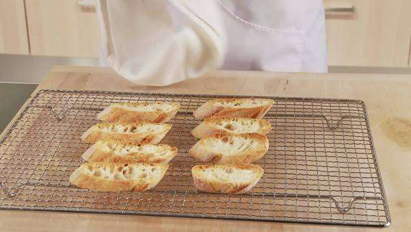 Toasted ciabatta slices on an oven rack Rights-managed stock video