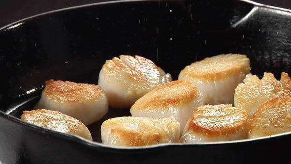 Scallops being seasoned with salt Rights-managed stock video