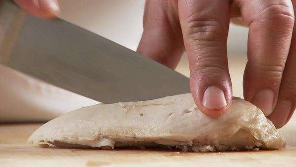 Cooked chicken breast being cut into small pieces Royalty-free stock video