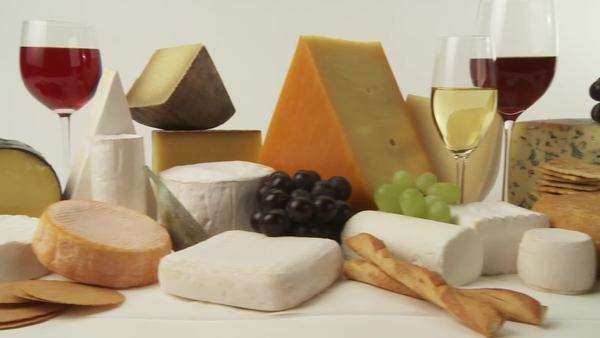 Various cheeses with wine, grapes and savoury biscuits Royalty-free stock video