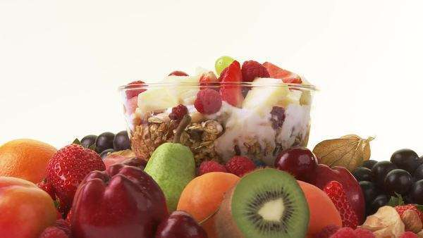 Assorted fruit and muesli with yoghurt, honey and berries Royalty-free stock video