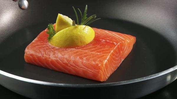 Salmon fillet in a frying pan Royalty-free stock video