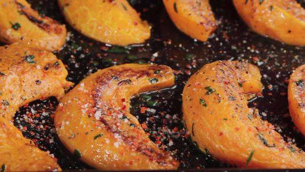 Roast pumpkin wedges on a baking tray Royalty-free stock video