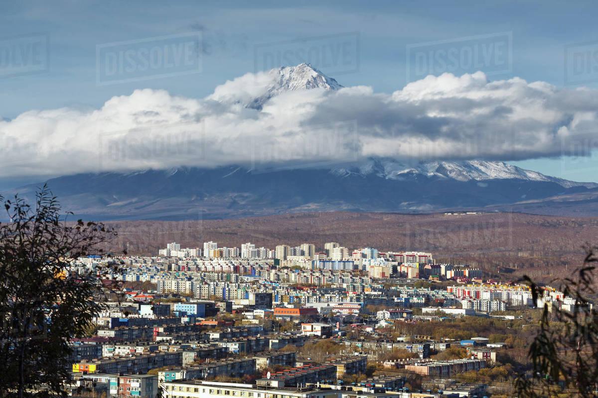Kamchatka autumn view of city landscape of Petropavlovsk-Kamchatsky City on background beautiful active Koryaksky Volcano. Kamchatka Region, Russian Far East, Eurasia. Royalty-free stock photo