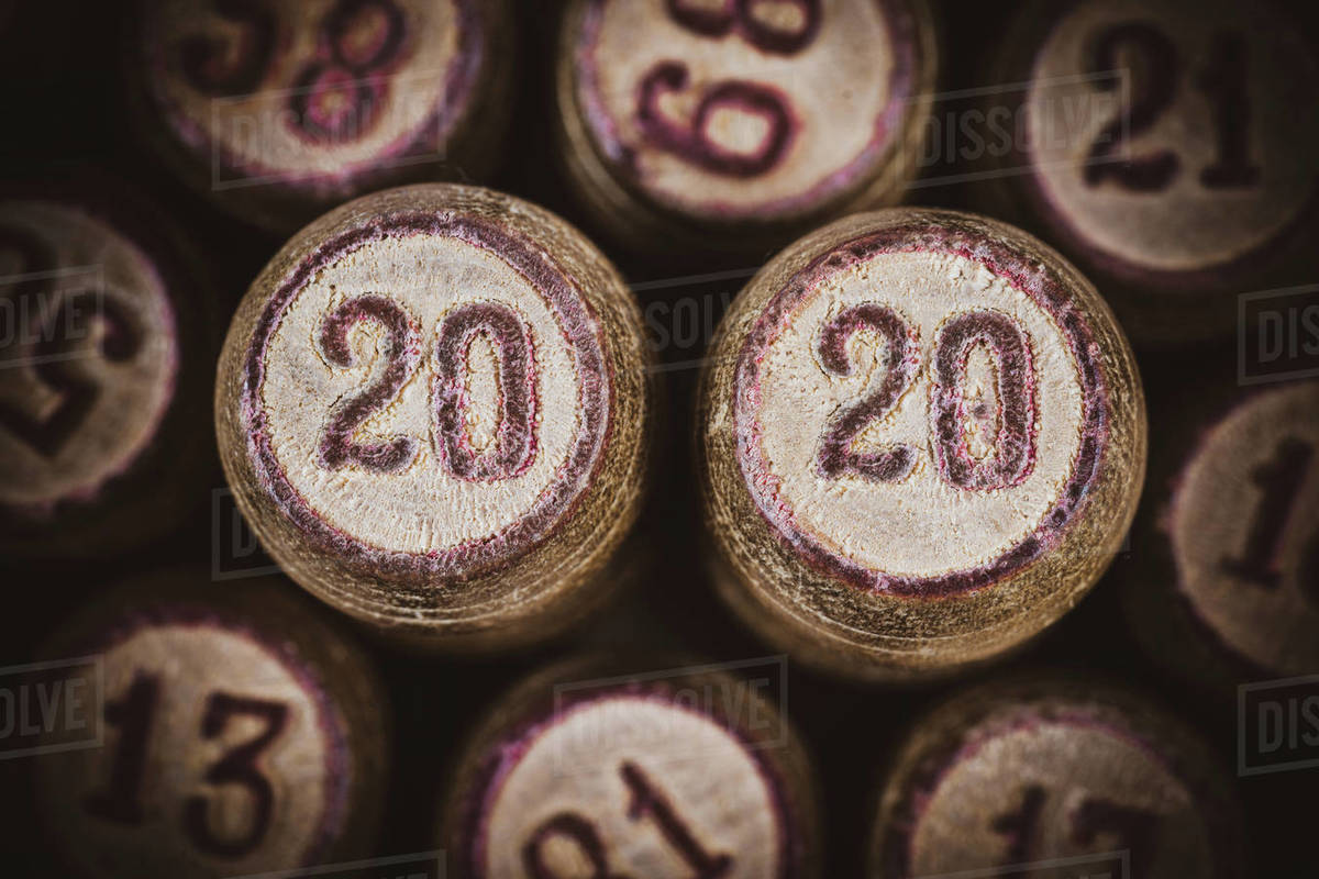 Vintage wooden lotto kegs with two numbers 20 and 20 as symbol of 2020 year. Close-up top view of 2020 New Year inscription. Vignette, trendy brown toning, vintage instant color photo effect old film Royalty-free stock photo