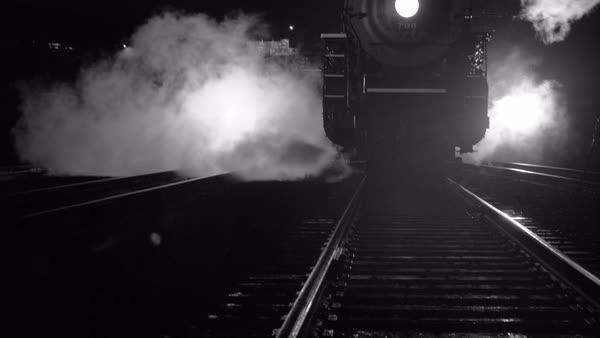 Steam locomotive at night  in black and white Royalty-free stock video