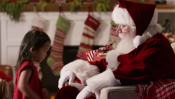Little girl sits with Santa Claus Royalty-free stock video