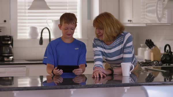 Grandson showing grandmother how to use tablet Royalty-free stock video