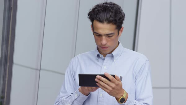 Young businessman using digital tablet outdoors Royalty-free stock video