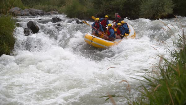 Super slow motion shot of group of people white water rafting Royalty-free stock video