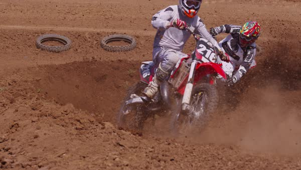 Motocross racers going around corner Royalty-free stock video