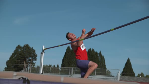Track athlete doing high jump in super slow motion Royalty-free stock video