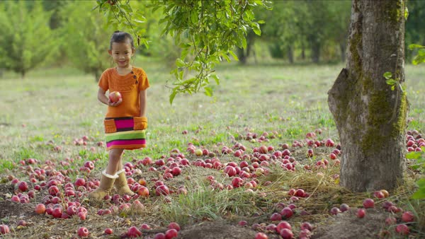 Young girl in Fall putting apple in pocket Royalty-free stock video