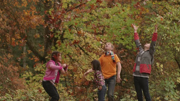 Group of kids in Fall throwing leaves Royalty-free stock video