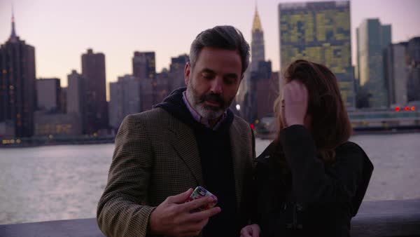 Couple in New York City taking cell phone selfie with city skyline in background Royalty-free stock video