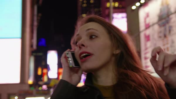 Woman talking on cell phone in Times Square, New York City Royalty-free stock video