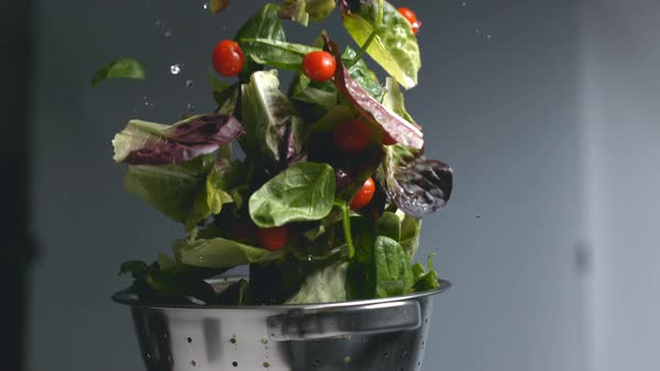 Salad flying out of colander in super slow motion Royalty-free stock video