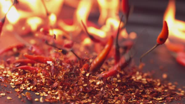 Peppers and flames in super slow motion Royalty-free stock video