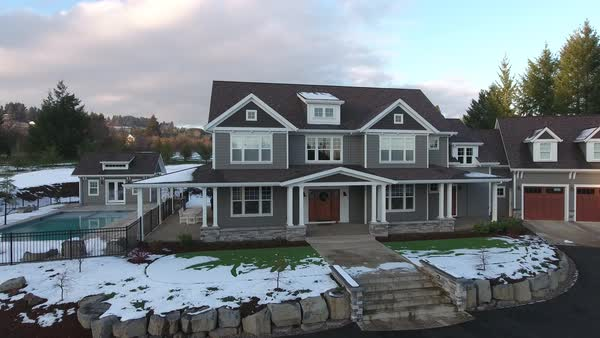 Aerial view of country home in winter with snow Royalty-free stock video