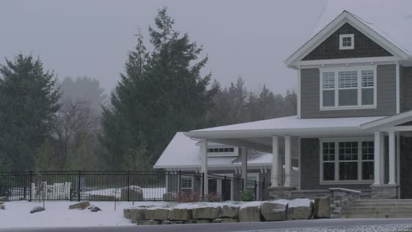 Country home in winter storm with snow falling Royalty-free stock video