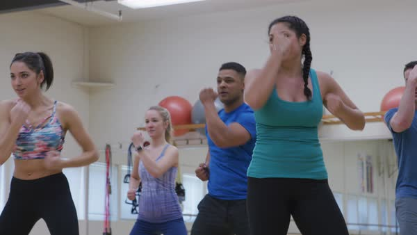 Group of people doing exercise class at gym Royalty-free stock video