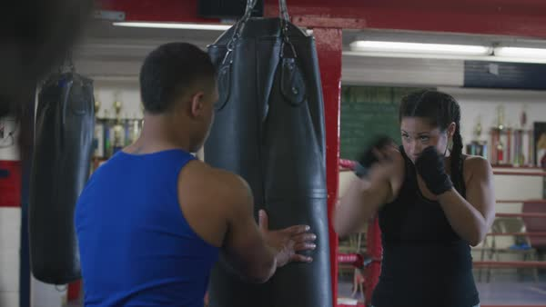 Woman and trainer working out at boxing gym Royalty-free stock video