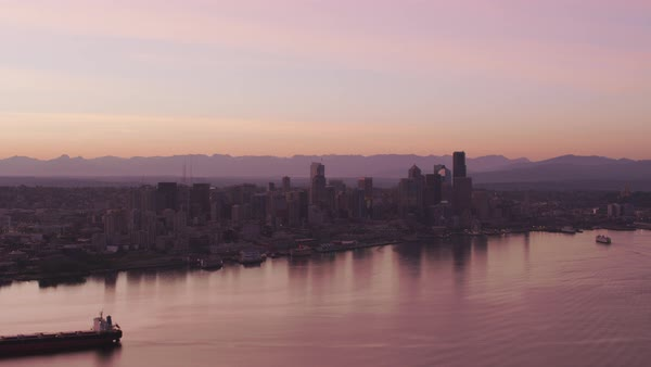 Aerial view of ship in front of Seattle skyline at sunrise.   Royalty-free stock video