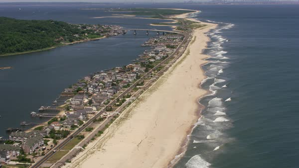 Flying up New Jersey beach towards Sandy Hook with New York City in distance.   Royalty-free stock video