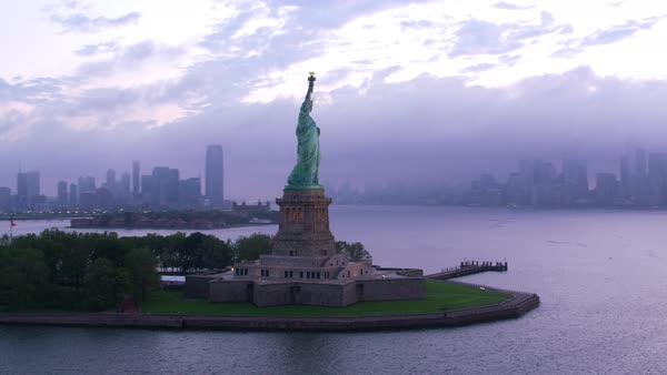 Aerial orbit of Statue of Liberty at sunrise.    Royalty-free stock video