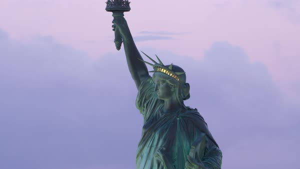 Close-up aerial view of Statue of Liberty at sunrise.   Royalty-free stock video