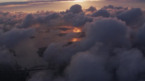 Aerial view of sunrise over clouds with New York City below.   Royalty-free stock video