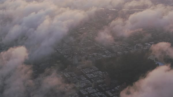 Aerial view of Central Park and Manhattan through clouds.   Royalty-free stock video