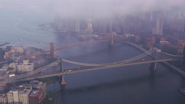 Aerial view of low clouds over Manhattan and Brooklyn bridges.   Royalty-free stock video