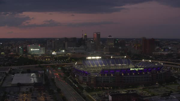 Aerial view of M&T Bank Stadium and Orioles Park at dusk.   Royalty-free stock video