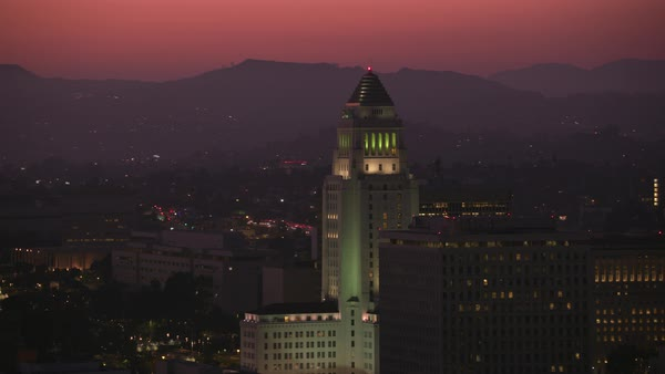 Aerial shot of Los Angeles city hall at dusk.   Royalty-free stock video