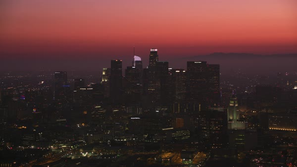 Aerial shot of Los Angeles at dusk with colorful sunset.   Royalty-free stock video