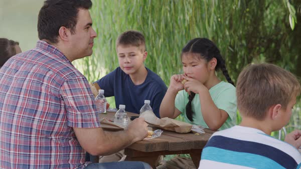 Kids at outdoor school having lunch together Royalty-free stock video