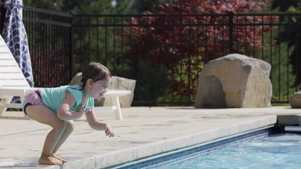 Young girl jumps to father in pool Royalty-free stock video