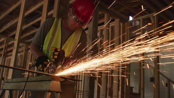 Construction worker grinding metal and making sparks Royalty-free stock video