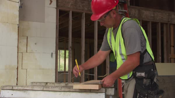 Construction worker cutting with circular saw Royalty-free stock video